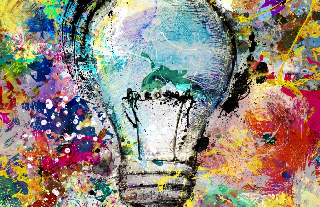 Glödlampa målad på en färggrann canvas.